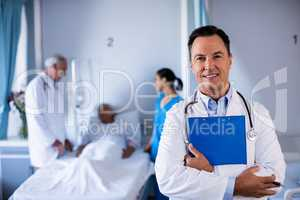 Portrait of male doctor holding medical report