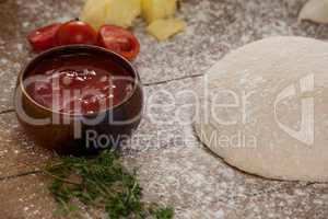 Pizza dough and flour with ingredient