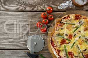 Various species with pizza arranged on a wooden tray