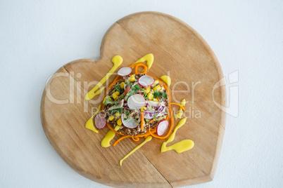 Vegetable salad on wooden board