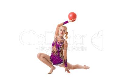 Pretty slim gymnast with red ball artistic portrait