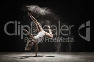 Graceful blonde dancing in white dust color