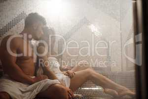 Sexy couple having rest in luxurious sauna