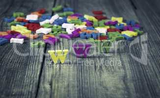 wooden  background with letters WWW