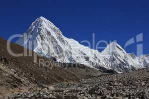 Azure blue sky over mount Pumori