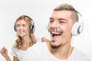 Young couple in headphones