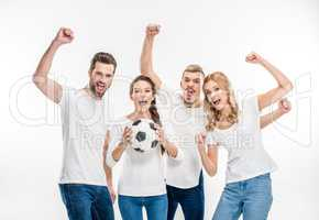 Cheerful friends with soccer ball