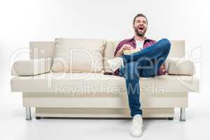 Man sitting on couch with popcorn