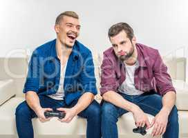 Friends playing with joysticks