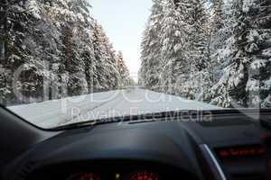 Passenger car moving along winter road