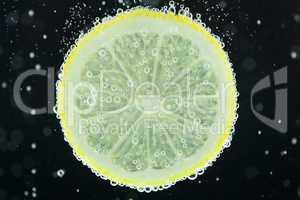Lemon slice diving into water