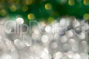 Abstract blurred background with silver and green bokeh