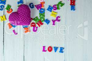 White wooden background with colorful letters