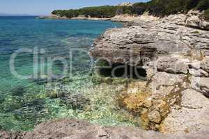 Rocks and turquoise blue water at Capo Testa