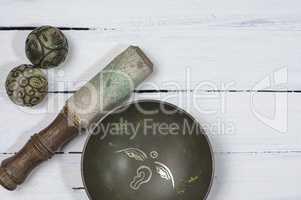 Copper Tibetan singing bowl with stone balls to religious ritual