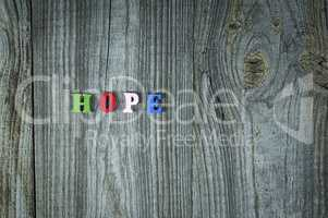 Words of hope from small multi-colored wooden letters