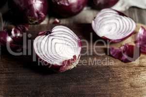 Red onions in the husk cut in half