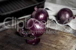 red onion on a kitchen cutting board