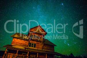 Milky way over wooden house