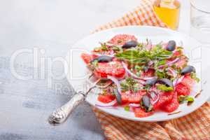 Grapefruit salad with olives, red onion, basil