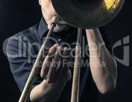 Playing trombone, close up shot