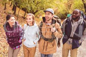 Happy young backpackers in forest