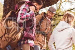 Young backpackers walking in forest