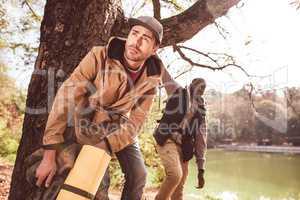 Men backpackers standing near river