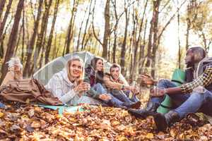 Young friends travelers in forest