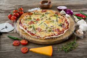 Various species with pizza arranged on wooden tray