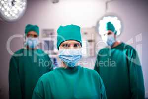 Portrait of medical team standing in a operating room
