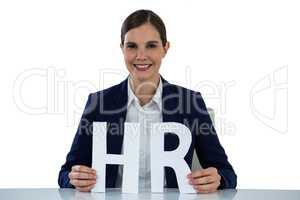 Conceptual image of businesswoman holding hr sign