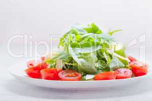 Salad with arugula, tomatoes