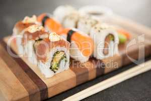 Assorted sushi set served on wooden board