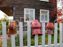 Сlay pots on the fence