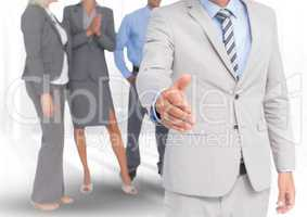 Handshake in front of business people in office