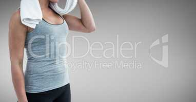 Fitness woman Torso after exercises against neutral grey background