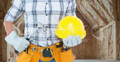 Carpenter torso with hammer in building site