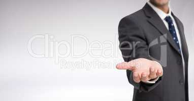 Businessman Torso who is stretching his hand against a neutral background