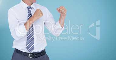 Businessman Torso with combative posture against neutral blue background