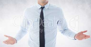 Businessman Torso showing his hands against neutral grey background