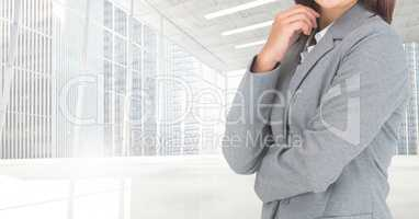 Composite image of Businesswoman Torso against modern place