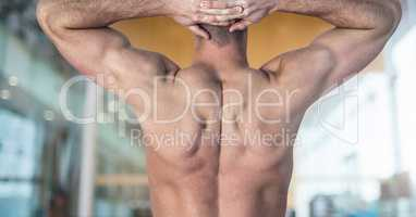 Back view of a Fitness Torso against gym club background