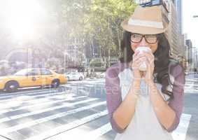 Woman drinking coffee on street with flare