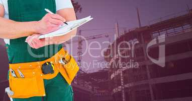 Carpenter with clipboard in building site with pink overlay