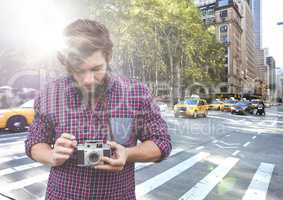 Man with camera on street with flare