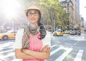 Composite image of Woman with hat and scarf on street with flare