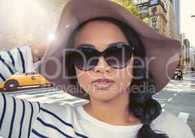 Composite image of Woman in summer hat against street in flare