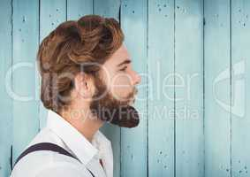 Man with beard against blue wood panel