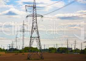 Electricity pylons through field
